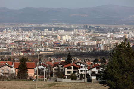 largest: Sofia, Bulgaria - March 7, 2016: Cityscape of the Bulgarian capital viewed from the Vitosha mount. Sofia is the 15th largest city in the European Union with population of more than 1.3 million people Editorial