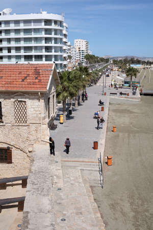 largest: Larnaca, Cyprus - March 12, 2016: Walking people at the embankment in a sunny springtime day. Larnaca is the third largest city of the country