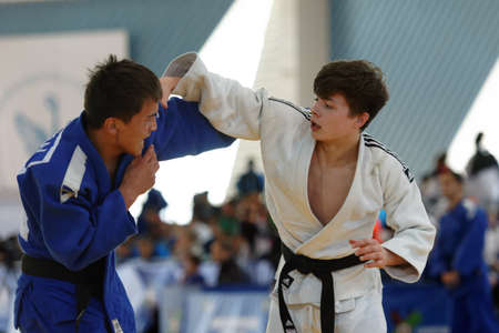 macdonald: St. Petersburg, Russia - April 16, 2016: Fight Baiaman Sagynbai Uulu of Kyrgyzstan (blue) vs Neil MacDonald of Great Britain during the Junior European Judo Cup. 346 athletes from 22 countries participated in the competition