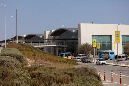 air travel: Larnaca, Cyprus - March 18, 2016: People and cars at the building of Larnaca International Airport. It is Cyprus main international gateway and the larger of the countrys two commercial airports