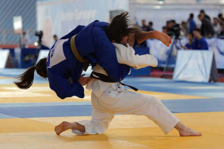 cup of russia: St. Petersburg, Russia - April 16, 2016: Match Gabriela Clemente of Brazil (blue) vs Viktoriia Soldatenkova of Russia during the Junior European Judo Cup. 346 athletes from 22 countries participated in the competition