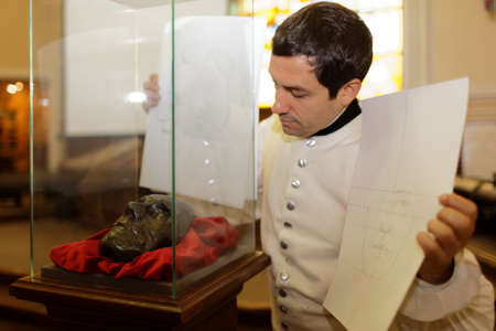 reconstructed: St. Petersburg, Russia - April 27, 2016: Author of �Suvorov. Alps. 200 years ago� Alexey Egorov shows the portrait of Generalissimo A. V. Suvorov reconstructed by his death mask in M. M. Gerasimov laboratory