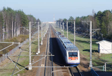 allegro: Solnechnoe, Leningrad oblast, Russia - May 1, 2016: High speed train Allegro built by French Alstom go from Helsinki to St. Petersburg. With maximum speed 220 kmh, the journey takes 3.5 hours Editorial