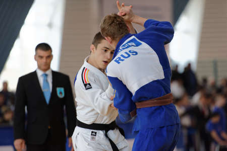 cup of russia: St. Petersburg, Russia - April 16, 2016: Fight Leon Philipp of Germany vs Dmitry Karpukhin of Russia during the Junior European Judo Cup. 346 athletes from 22 countries participated in the competition