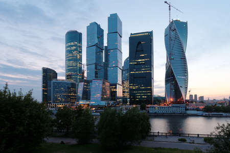 billions: Moscow, Russia - June 30, 2014: Moscow international business center Moscow City in evening. The construction started in 1995, costs for the present about $12 billions, and have to be finished in 2017