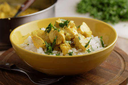 chicken curry: Chicken curry with parsley and rice