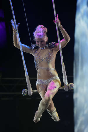 trapeze: St. Petersburg, Russia - June 2, 2016: Trapeze artist Olga Shmeleva in the dress rehearsal of the Show of Water, Fire, And Light in the Ciniselli circus. This new show of Anatoly Sokol first time arrived in St. Petersburg Editorial