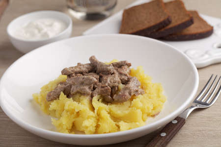 beef stroganoff: Beef Stroganoff with mashed potato and sour cream