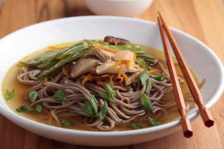 meatless: Japanese shiitake, soba, and green bean soup Stock Photo