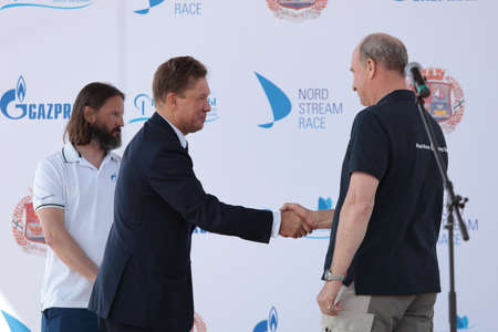 miller: St. Petersburg, Russia - June 4, 2016: Handshake of skipper of team Great Britain Adrian Lower (right) and Chairman of the Management Committee of Gazprom Alexey Miller during the opening ceremony of the Nord Stream Race