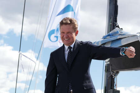 nord: St. Petersburg, Russia - June 4, 2016: Chairman of the Management Committee of Gazprom Alexey Miller looking to the watch showing the time of the Nord Stream Race. Five teams compete in the race this year Editorial