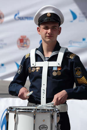 nord: St. Petersburg, Russia - June 4, 2016: Unidentified drummer from the band of Kronstadt naval cadet corps during the opening ceremony of the Nord Stream Race. Five teams compete in the race this year