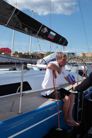 skipper: St. Petersburg, Russia - June 4, 2016: Skipper Sergey Borodinov at the yacht Bronenosec of Russia talks with press before the opening ceremony of the Nord Stream Race. Five teams compete in the race this year