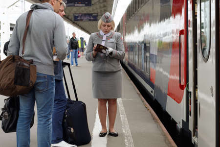 ulyanov: St. Petersburg, Russia - May 28, 2016: Passengers at the double-decker train Mikhail Ulyanov in the day of its first departure from St. Petersburg to Adler. The train is operated by Russian Railways Editorial