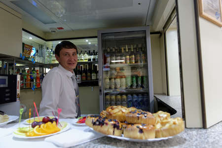 ulyanov: St. Petersburg, Russia - May 28, 2016: Staff in the cafe of the double-decker train Mikhail Ulyanov in the day of its first departure from St. Petersburg to Adler. The train is operated by Russian Railways