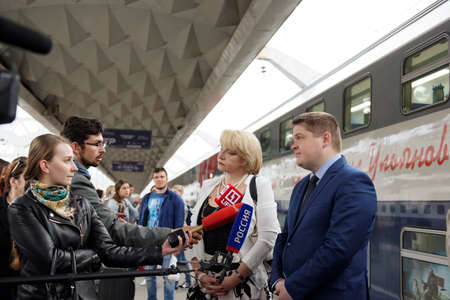 ulyanov: St. Petersburg, Russia - May 28, 2016: Deputy director of JSC FPK Stanislav Zotin (right) and President of the Mikhail Ulyanovs foundation Elena Ulyanova talk with press at the double-decker train Mikhail Ulyanov in the day of its first departure from St