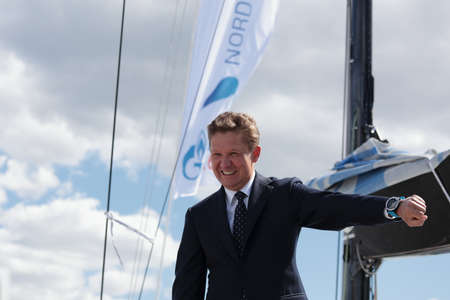 the chairman: St. Petersburg, Russia - June 4, 2016: Chairman of the Management Committee of Gazprom Alexey Miller looking to the watch showing the time of the Nord Stream Race. Five teams compete in the race this year Editorial