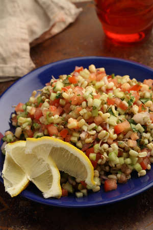 mung bean: Tabbouleh salad with mung bean sprouts, lemon, and vegetables Stock Photo
