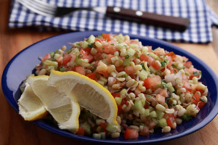 tabbouleh: Tabbouleh salad with mung bean sprouts, lemon, and vegetables Stock Photo