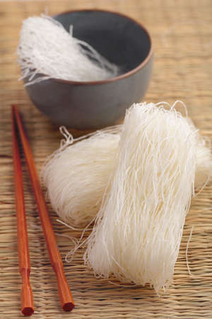 straw mat: Cellophane noodles on a straw mat Stock Photo