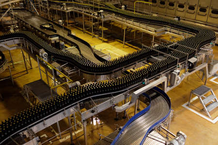St. Petersburg, Russia - August 11, 2016: Beer conveyor in the Heineken brewery. In 2003, it was the first Heineken brewery in Russia, and now it can produce over 5 millions HL of beer per year Editorial