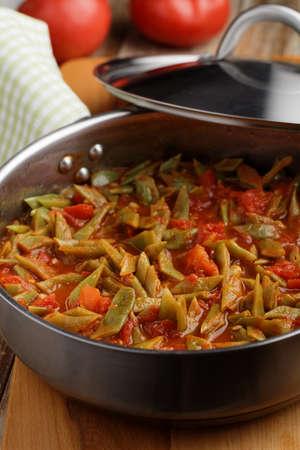green bean: Green bean stew in a cooking pan