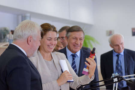 manufactory: St. Petersburg, Russia - August 9, 2016: General director of Imperial Porcelain Manufactory Tatyana Tylevich shows the factorys production to vice-governor of St. Petersburg Igor Divinsky (left) during his working visit to the enterprise