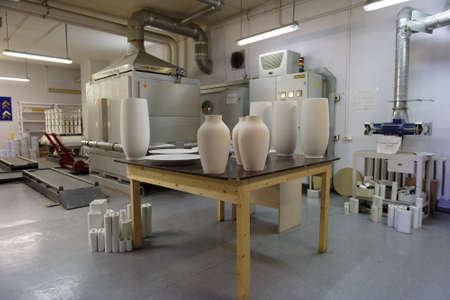 manufactory: St. Petersburg, Russia - August 9, 2016: Production of Imperial porcelain manufactory in workshop. Founded in 1744 by order of Empress Elisabeth, now the factory produces about 4000 items Editorial