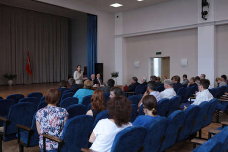 manufactory: St. Petersburg, Russia - August 9, 2016: General director of Imperial Porcelain Manufactory Tatyana Tylevich during the meeting of vice-governor of St. Petersburg Igor Divinsky (center) with factory workers Editorial