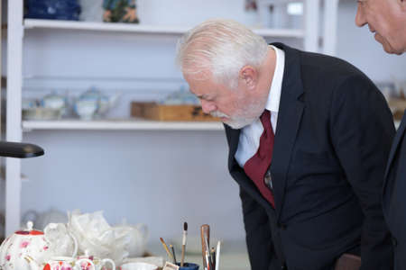 manufactory: St. Petersburg, Russia - August 9, 2016: Vice-governor of St. Petersburg Igor Divinsky during his working visit to the Imperial Porcelain Manufactory. The enterprise was founded in 1744