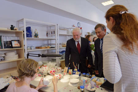 manufactory: St. Petersburg, Russia - August 9, 2016: Vice-governor of St. Petersburg Igor Divinsky (center) during his working visit to the Imperial Porcelain Manufactory. The enterprise was founded in 1744 Editorial
