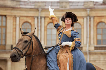 empress: Gatchina, St. Petersburg, Russia - September 10, 2016: Actress in image of Empress Catherine II on a horse during the festival Gatchinskaya Byl. The festival is held first time this year Editorial