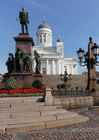 reestablishment: Helsinki, Finland - August 21, 2016: Statue of Russian Emperor Alexander II on Senate square against Helsinki Cathedral. The statue, erected in 1894, was built to commemorate his re-establishment of the Diet of Finland in 1863