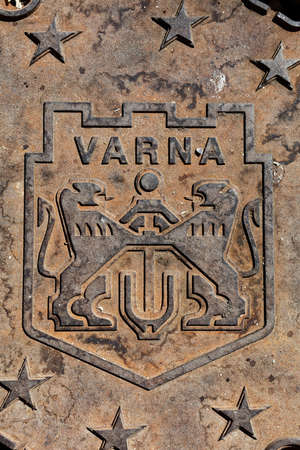 city coat of arms: Arms of city of Varna, Bulgaria on the manhole cover