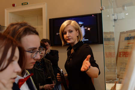 insider: St. Petersburg, Russia - October 7, 2016: People in the exhibition dedicated to 85th anniversary of Russian bestselling author Julian Semyonov in the Presidential library. People call him The Consummate Insider