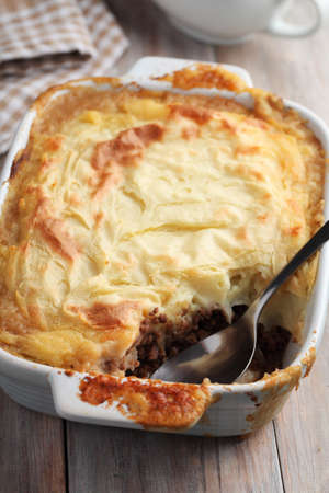 british cuisine: Cottage pie in a rustic baking dish Stock Photo