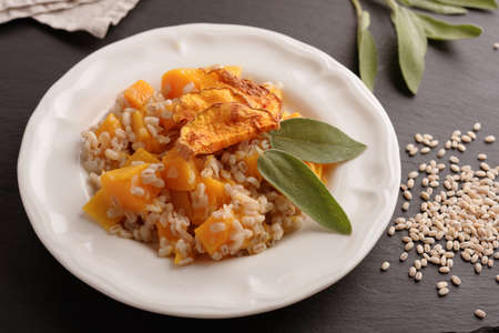 butternut: Pearl barley risotto with pumpkin and sage leaf Stock Photo