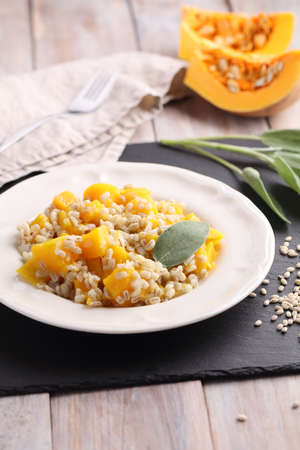 meatless: Pearl barley risotto with pumpkin and sage leaf Stock Photo