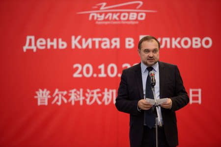 delivers: St. Petersburg, Russia - October 20, 2016: Commercial director of VVSS Ltd Eugene Ilyin delivers opening remarks during the China Day in Pulkovo airport. The event is organized by the airport administration, three Chinese airlines companies, and the Gener Editorial