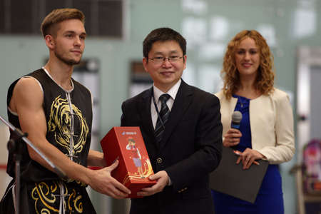 St. Petersburg, Russia - October 20, 2016: Representative of China Southern Airlines give the prize to the member of St. Petersburg Wushu team during the China Day in airport Pulkovo. The event is organized by the airport administration, three Chinese air Editorial