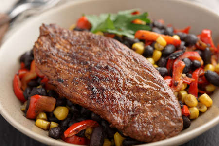 black bean: Roasted turkey meat with black bean salad on a slate surface Stock Photo