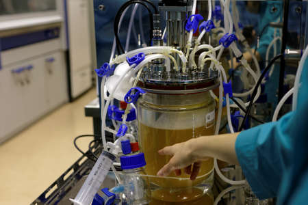 throughput: St. Petersburg, Russia - November 16, 2016: Researcher at bioreactor in the High-Throughput Biotechnology Laboratory of BIOCAD. It is one of the world`s few full-cycle drug development and manufacturing companies