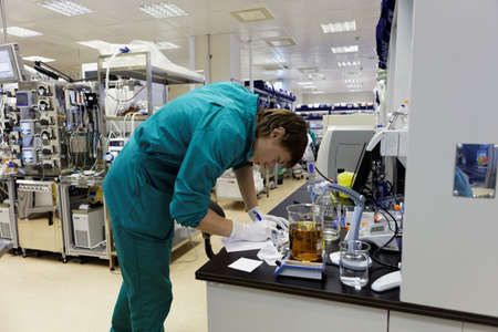 laboratory labware: St. Petersburg, Russia - November 16, 2016: Researchers at work in the High-Throughput Biotechnology Laboratory of BIOCAD. It is one of the world`s few full-cycle drug development and manufacturing companies Editorial