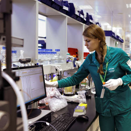 laboratory labware: St. Petersburg, Russia - November 16, 2016: Researcher Anastasia Kozlova at work in the High-Throughput Biotechnology Laboratory of BIOCAD. It is one of the world`s few full-cycle drug development and manufacturing companies Editorial