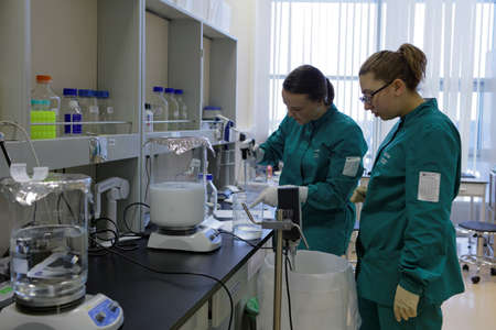 St. Petersburg, Russia - November 16, 2016: Researchers at work in the High-Throughput Biotechnology Laboratory of BIOCAD. It is one of the world`s few full-cycle drug development and manufacturing companies Editorial