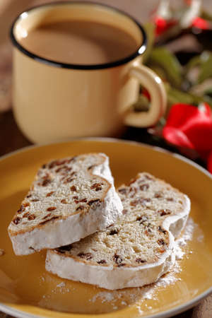 Slices of Christstollen on a Christmas table Stock Photo