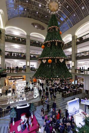 Stockholm, Sweden - November 27, 2016: People in the Nordiska Kompaniet department store during Christmas sale. Founded in 1902, NK stays must see place in Stockholm Sajtókép