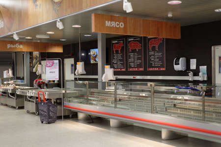 St. Petersburg, Russia - November 29, 2016: Empty shelves in meat and fish departments of the Finnish hypermarket K-Ruoka. Next day K-Ruoka closes all hypermarkets in Russia selling the business to Lenta
