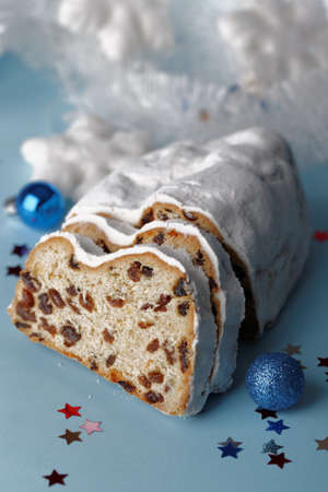 Stollen and Christmas decorations on blue background Stock Photo
