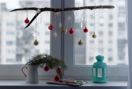 christmas decoration and lantern with candle on a window sill stock photo 68211597